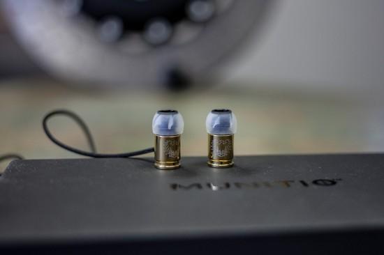 munitio nines earbuds earphones bullets- close-up shot